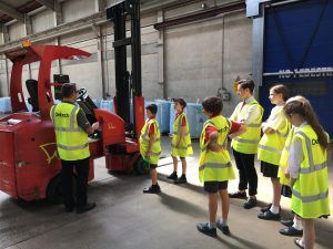 The pupils listening to our Warehouse Manager Martin Page, explain how the equipment works.