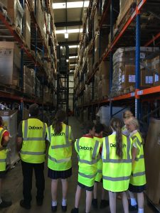 The pupils are shown the racking in our warehouse